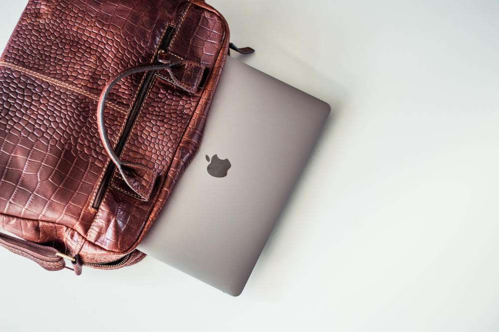 briefcase laptop financial reporting